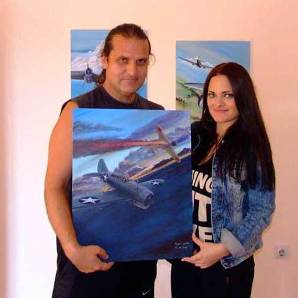 Buffalo painting handed to new cute owner